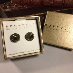 Sorrelli grey crystal and gold tone earrings.